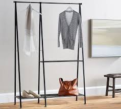 perhaps more aesthetically pleasing options include the modular clothes rack at pottery barn above or this wooden clothing rack from urban outfitters