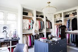 alice lane home stunning walk in closet features a clear beaded tiered chandelier aerin jacqueline chandelier illuminating a blue closet island accented