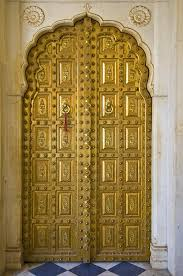 a gold plated door in the city palace plex