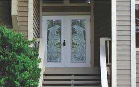 Dolphins etched on double front doors