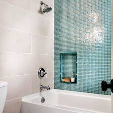 Shower with blue glass wall and 12 x 24
