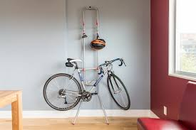 Bike hanger for apartment Mountain Bike Bike And Helmet On The our Pick Bike Rack On An Apartment Wall Wirecutter The Best Bike Racks For Small Homes And Apartments Reviews By