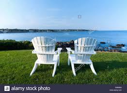 adirondack chairs on beach. Two White Adirondack Chairs On A Lawn Overlooking The Atlantic Ocean In  York Beach, Maine Adirondack Beach O