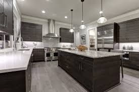 kitchen with dark cabinets and stainless steel appliances