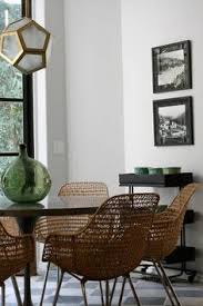 modern woven wicker chairs are the eyecatcher in this dining room they fit perfectly into this room with clear lines and a geometric l