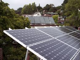photovoltaic foreground and solar water heating rear panels located on rooftops in berkeley california note the low tilt of the photovoltaic panels