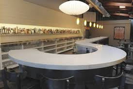 sickle shape white concrete countertop in a fancy restaurant lounge