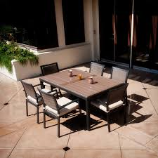 modern patio furniture with mid century dining chairs and rustic dining table plus concrete flooring