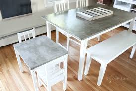 a step by step tutorial to make a diy concrete table top that is