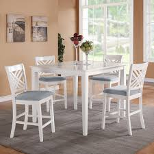 rectangle white wooden table with four legs combined with white wooden chairs plus crossed back and