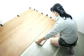 best way to remove vinyl flooring from concrete beautiful woman puts laminate removing floor tiles wood