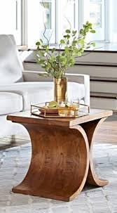 two opposing demi circles create the base of our sculptural bergen side table accent table decor accent tablesliving