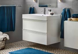 White high gloss bathroom vanity featuring cabinet with two drawers, and  white porcelain sink with