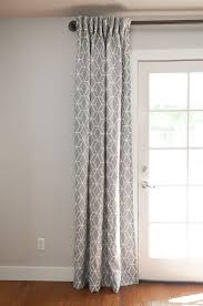 gray curtains over french doors but possibly with a navy wall beige