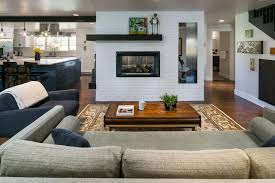 midcentury living areas with double sided fireplace jordan iverson