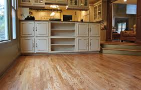 refinishing and painting old and rustic kitchen cabinet with white color and hardwood floor tiles ideas