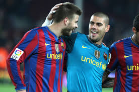 Barça Beef: Victor Valdes gives Gerard Pique the finger during on pitch argument v Real Sociedad