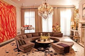 chandelier fireplace large chandelier large painting mantel o round coffee table round sofa sculpture sectional sofa sheer curtains splatter swing
