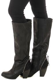 black faux leather black faux leather tall boot with crochet heel and zipper detail left side black faux leather