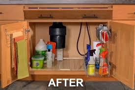 under kitchen sink cabinet. Kitchen Sink Cabinet Open To Show Pull-out Storage Baskets, Towel Bar, Drip Under