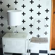 urban wall decals small black plus sign wall decals evenly spaced on a white wall behind urban wall decals