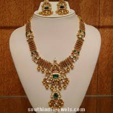 gold antique emerald and polki studded necklace