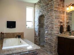 rustic stone bathroom designs. gorgeous bathroom with rustic stone wall and shower area for stylish look designs r