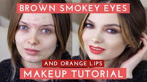 brown smokey eyes orange lips makeup