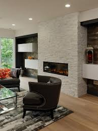 floating shelves on either side of this white stone fireplace enhance this living room s contemporary look