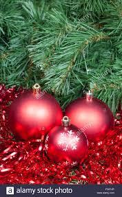 Vertical Christmas Still Life Three Red Christmas Balls Tinsel On