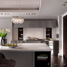 modern contemporary kitchen design with sliding doors pantry kitchen island with quartz countertops and ochre arctic pear chandelier