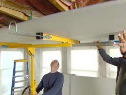 installing drywall on a ceiling