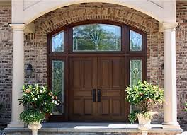 double entry doors with arched transom and custom art glass
