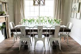 farm table with metal chairs statement light fixture home living spaces within