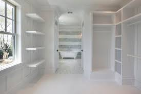 master bedroom features walk through closet filled with custom built ins and stacked shelves leading to master bathroom