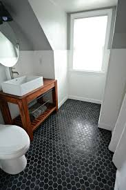 black hex tiles make a statement in this neutral bathroom