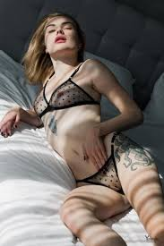 Akari Y Bambino Tattooed Brunette Is Posing Naked On Her Bed Taking Off Her Clot R18hub