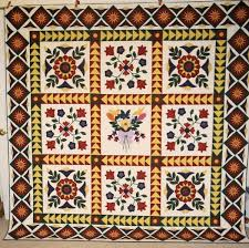 Storytelling Through Appliqué: Folk Art Quilts & Folk Art Quilt with Flowers and Diamond-Patterned Border Adamdwight.com