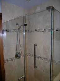 bathroom walk in shower with steel vertical grab safety handles on