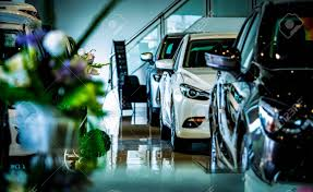 Auto Mobile Office New Luxury Shiny Compact Car Parked In Modern Showroom Car Dealership