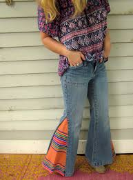 rainbow woven guatemalan fabric upcycled bell bottom jeans pants size 7 with matching pockets by mountaingirlclothing