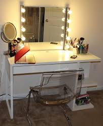 rectangle white wooden vanity table with side shelves combined with rectangle mirror with lamps around
