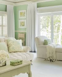 Stunning ivory and mint green bedroom features mint green walls adorned  with white chair rail trim