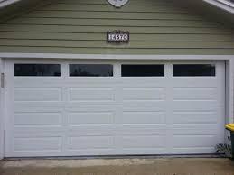 garage door repair jacksonville flAmarr long panel garage door with solid windows gives this home in