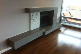 contemporary floating concrete fireplace surround