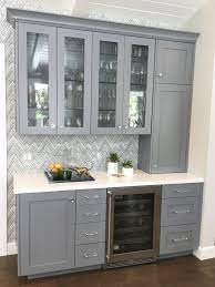 Custom built-in bar with grey cabinetry ...