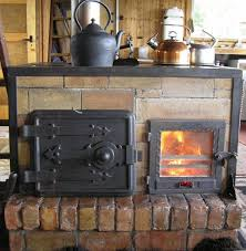 the design is not classic rocket stove but includes elements of it it s a horizontal front load batch fed mass stove with cook top