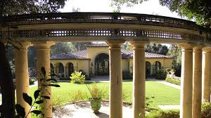 also on madeline you ll see an original pergola that stands as a gateway to the gardens former natatorium now standing guard in front of a private home