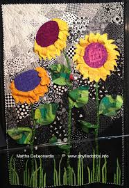 3-D Sunflowers – by Martha DeLeonardis. Design source – a vintage ... & Design source – a vintage sunflower block quilt. The techniques used were  turned edge woven fabric, machine pieced, applique and quilted. Adamdwight.com