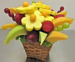 Fruit In Flower Arrangements How To Make Your Own Edible Fruit Arrangement  Decorating Fruit And Flower